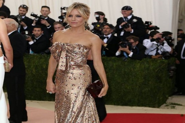 Sienna Miller rocking a full-on sequin dress